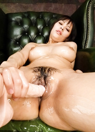 Kyouko Maki pushes nipples of her big oiled cans with fake cock