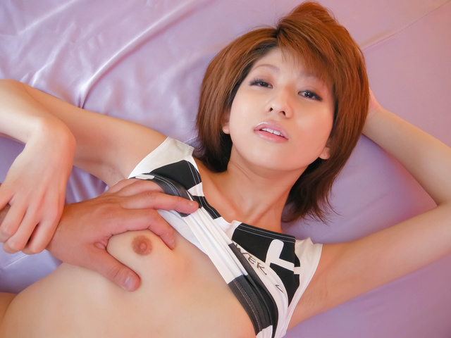 Rei Sasaki - Kinky redhead babe Rei Sasaki stripping off in her latex rubbing her snatch and giving a foot rub - Picture 2