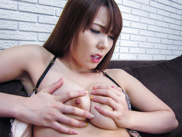 Yui Hatano - Busty Yui Hatano playing with a stiff Asian dildo - Picture 1