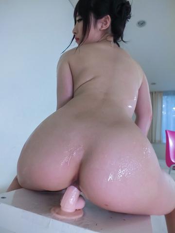 Arisa Nakano - Arisa Nakano rides a japanese dildo while she's oiled up - Picture 11