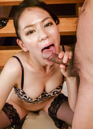 Kei Akanishi in animal print shows nude pussy while sucking tool