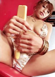 Amazing Yuu Mahiru shoves a huge white and pink dildo inside