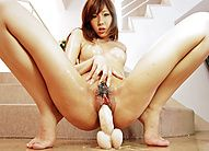 Gorgeous Serina Hayakawa slides her peach onto a thick dildo
