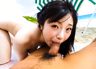 Hina Maeda Asian sucks penises and gets them in snatch on sand