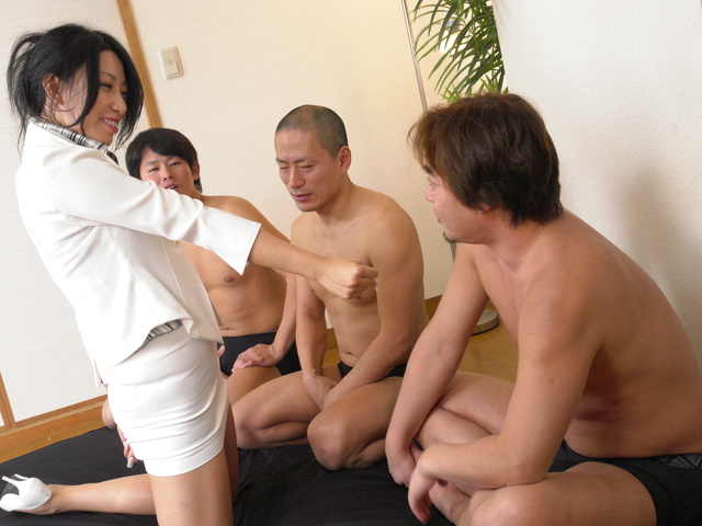 Chris Ozawa - The shaved pussy of Chris Ozawa gets fucked by three guys - Picture 1