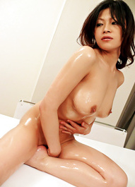 Ryo Sasaki Asian caresses her body with oil before getting dildo