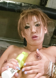 Hina Maeda Asian plays with vibrator on cans and cloth on twat