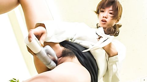Japanese chick on her knees wanking and sucking two dicks